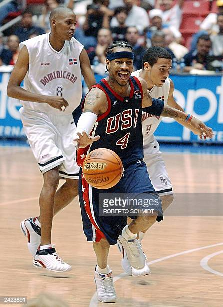 Allen Iverson a member of the US Men's national team sticks his tongue moments after a Dominican player was called with a foul during his team's...