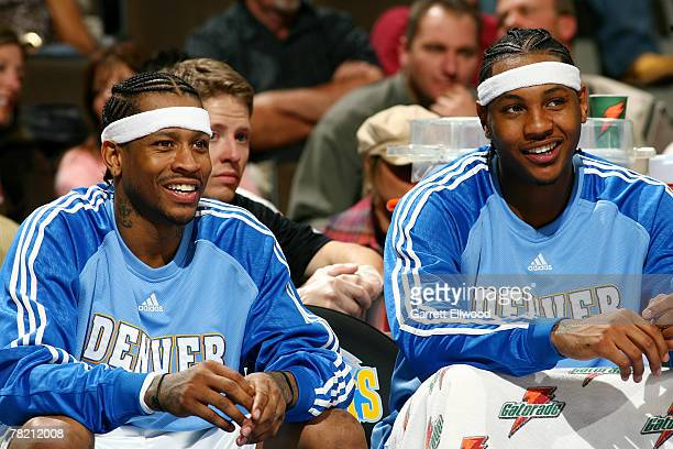 Allen Iverson and Carmelo Anthony of the Denver Nuggets share a laugh during the game against the Miami Heat at the Pepsi Center December 2 2007 in...
