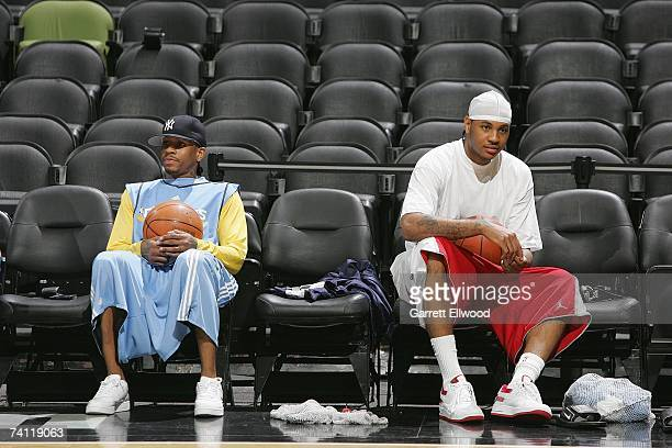 Allen Iverson and Carmelo Anthony of the Denver Nuggets sit on the sideline during practice for the Western Conference Quarterfinals against the San...