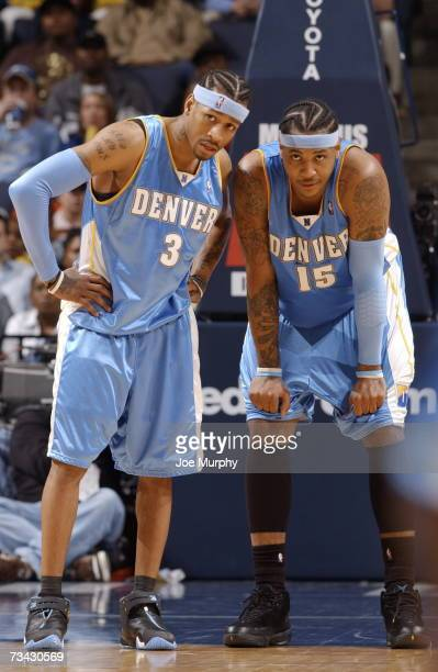 Allen Iverson and Carmelo Anthony of the Denver Nuggets talk strategy on February 26 2007 at FedExForum in Memphis Tennessee NOTE TO USER User...