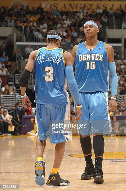 Allen Iverson and Carmelo Anthony of the Denver Nuggets walk on the court during the NBA game against the Los Angeles Lakers at Staples Center on...