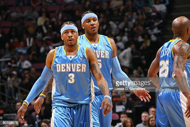 Allen Iverson and Carmelo Anthony of the Denver Nuggets walk the floor after a foul during a game against the New Jersey Nets on March 21 2008 at the...