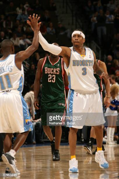 Allen Iverson and Earl Boykins of the Denver Nuggets celebrate against the Milwaukee Bucks on January 8 2006 at the Pepsi Center in Denver Colorado...