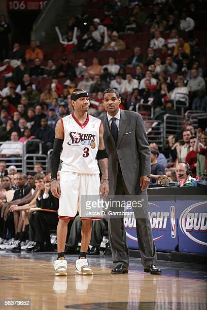 Allen Iverson and head coach Maurice Cheeks of the Philadelphia 76ers look on during the game against the Milwaukee Bucks on December 7 2005 at the...