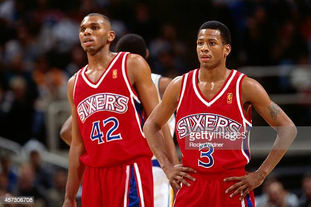Allen Iverson and Jerry Stackhouse of the Philadelphia 76ers looks on against the Golden State Warriors on January 3, 1997 at the Arena in Oakland in...