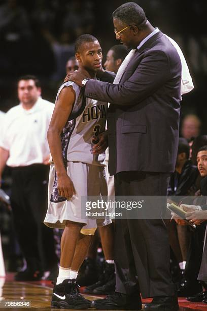 Allen Iverson and John Thompson head coach of the Georgetown Hoyas talk during a basketball game against the Boston College Eagles at US AIr Arena on...