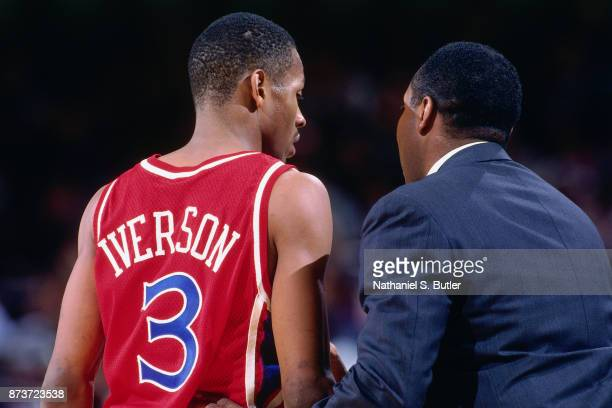 Allen Iverson and Johnny Davis of the Philadelphia 76ers talks during a game played on November 12, 1996 at Madison Square Garden in New York City ....