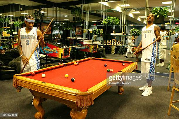 Allen Iverson and JR Smith of the Denver Nuggets play pool before the game against the Charlotte Bobcats on January 29 2007 at the Pepsi Center in...