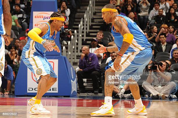 Allen Iverson and Kenyon Martin of the Denver Nuggets slap hands during the game against the Los Angeles Clippers at Staples Center on October 31...