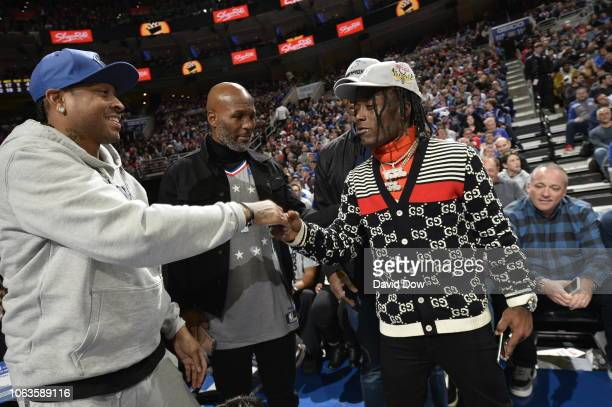 Allen Iverson and Lil Uzi Vert exchange handshakes during the game between the Phoenix Suns and Philadelphia 76ers on November 19 2018 at the Wells...