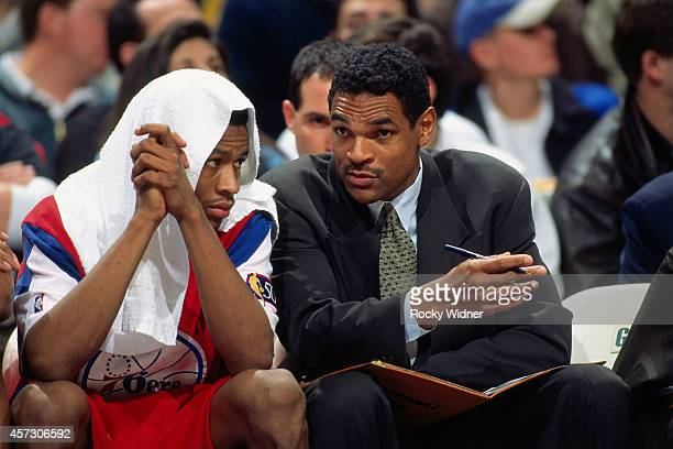 Allen Iverson and Maurice Cheeks of the Philadelphia 76ers talk against the Golden State Warriors on January 3, 1997 at the Arena in Oakland in...