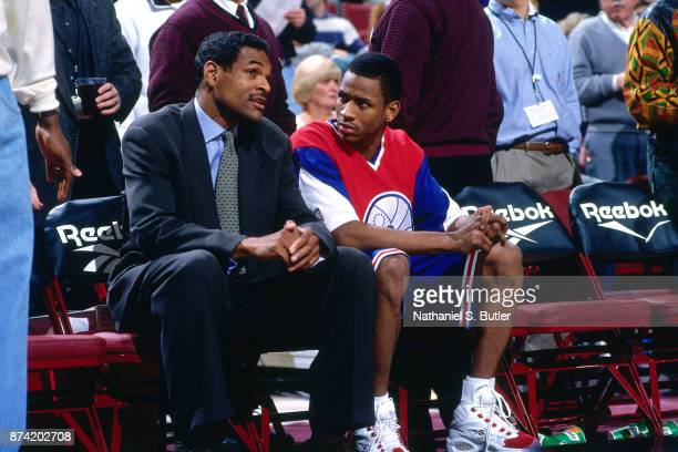 Allen Iverson and Maurice Cheeks of the Philadlephia 76ers speak during a game played on November 23 1996 at the First Union Arena in Philadelphia...