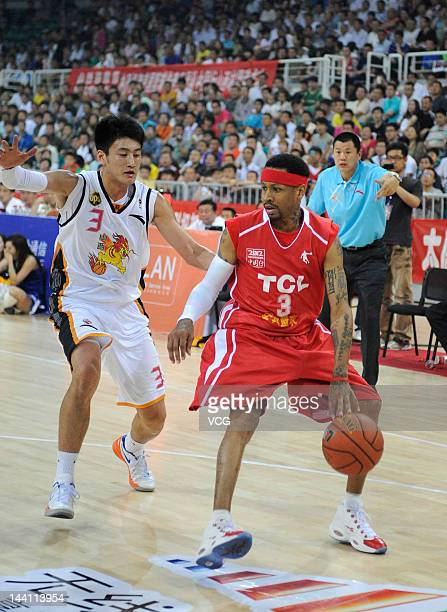 Allen Iverson drives the ball in a match against Shanxi Zhongyu during the US Proball Legend China Tour 2012 at Shanxi Sports Center on May 8 2012 in...