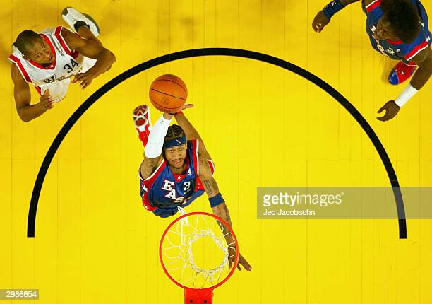 Allen Iverson from the Philadelphia 76ers of the Eastern Conference AllStars grabs a rebound over the Western Conference AllStars during the 2004 NBA...