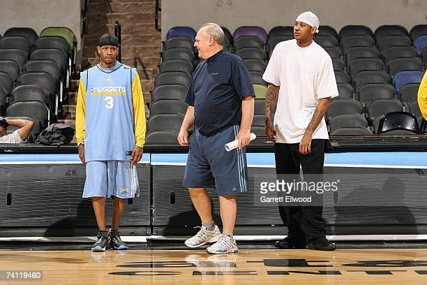 Allen Iverson head coach George Karl and Carmleo Anthony of the Denver Nuggets stand on the sideline during practice prior to Game One of the Western...
