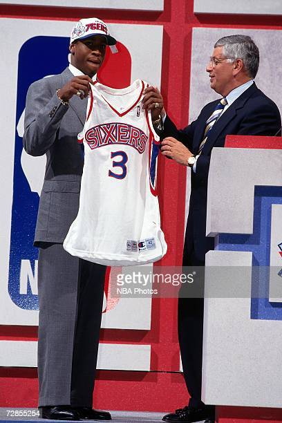 Allen Iverson holds up a76ers uniform with NBA Commissioner David Stern after being drafted by the Philadelphia 76ers in the first round of the 1996...
