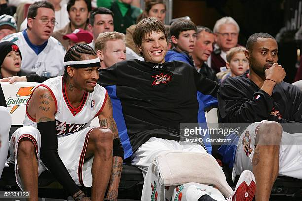 Allen Iverson Kyle Korver and Aaron McKie of the Philadelphia 76ers look on from the bench against the Atlanta Hawks on February 4 2005 at the...