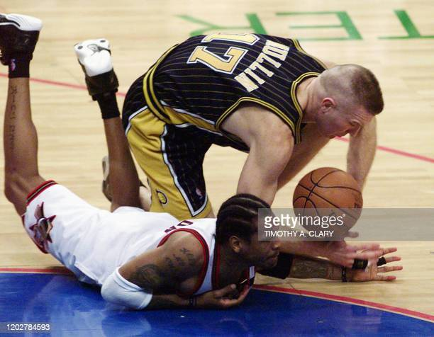 Allen Iverson of Philadelphia 76ers and Chris Mullin of the Indiana Pacers fight for a lose ball during the 4th quarter of Game 4 of the NBA Eastern...