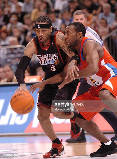 Allen Iverson of Philadelphia and JR Holden of CSKA Moscow tussle for the ball during the NBA Europe Live Tour presented by EA Sports on October 11,...