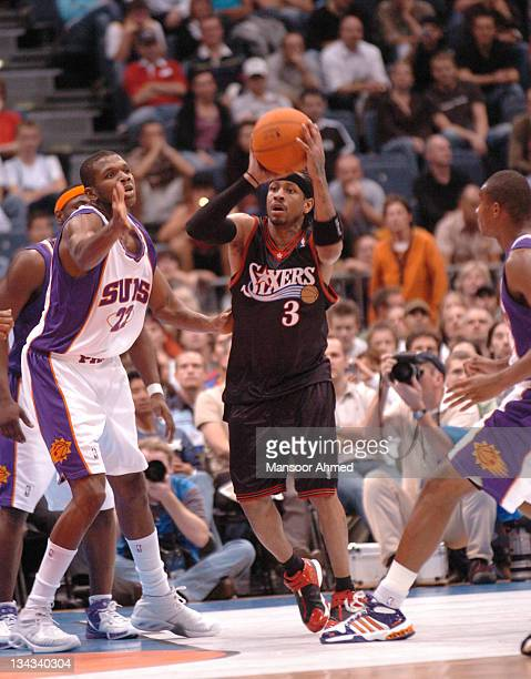 Allen Iverson of Philadelphia looks to pass away from the hands of Phoenix Suns' polayer James Jones during the NBA Europe Live Tour presented by EA...