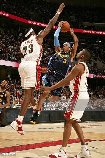 Allen Iverson of the Denver Nuggets attempts a shot defended by LeBron James of the Cleveland Cavaliers at The Quicken Loans Arena February 10 2008...