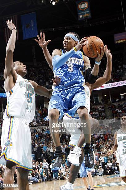 Allen Iverson of the Denver Nuggets attempts to shoot the ball against Rasual Butler of the New Orleans/Oklahoma City Hornets during a game on April...