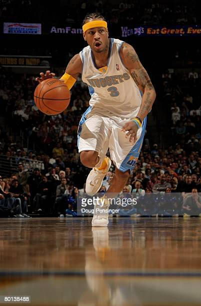 Allen Iverson of the Denver Nuggets controls the ball against the Phoenix Suns at the Pepsi Center on March 5 2008 in Denver Colorado The Nuggets...