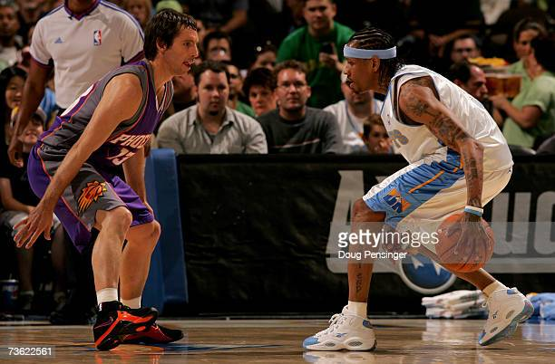 Allen Iverson of the Denver Nuggets controls the ball as Steve Nash of the Phoenix Suns defends during NBA action at the Pepsi Center on March 17...