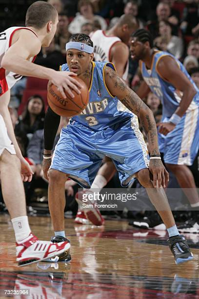 Allen Iverson of the Denver Nuggets defends against Sergio Rodriguez of the Portland Trail Blazers during a game at the Rose Garden Arena on January...