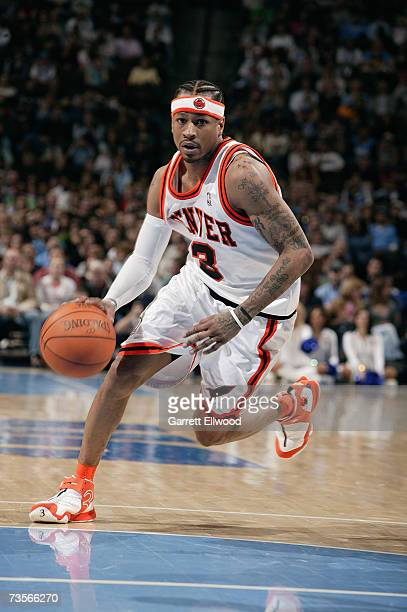 Allen Iverson of the Denver Nuggets dribble drives to the basket against the Utah Jazz during the game on February 23 2007 at the Pepsi Center in...