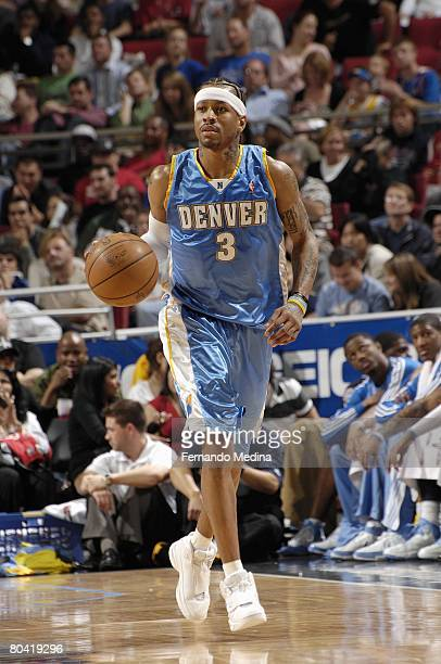 Allen Iverson of the Denver Nuggets dribbles downcourt against the Orlando Magic at Amway Arena on February 13 2008 in Orlando Florida NOTE TO USER...