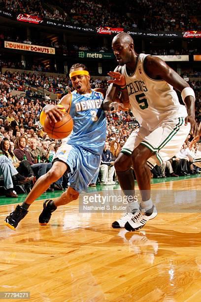 Allen Iverson of the Denver Nuggets drives against Kevin Garnett of the Boston Celtics at TD Banknorth Garden November 7 2007 in Boston Massachusetts...