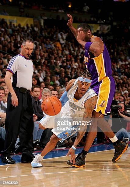 Allen Iverson of the Denver Nuggets drives around Kobe Bryant of the Los Angeles Lakers as the Nuggets defeated the Lakers during NBA action at the...