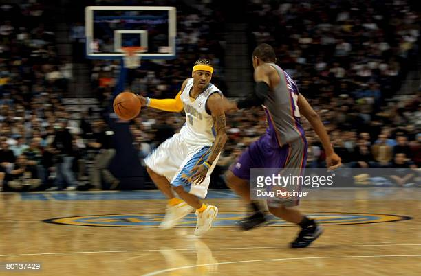 Allen Iverson of the Denver Nuggets drives around Leandro Barbosa of the Phoenix Suns at the Pepsi Center on March 5 2008 in Denver Colorado The...