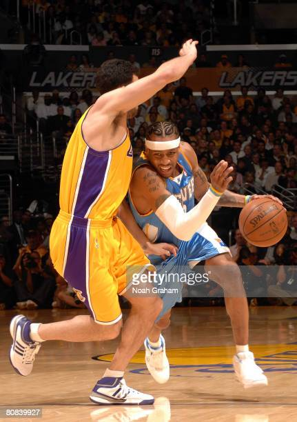 Allen Iverson of the Denver Nuggets drives on Jordan Farmar of the Los Angeles Lakers in the first half of Game Two of the Western Conference...
