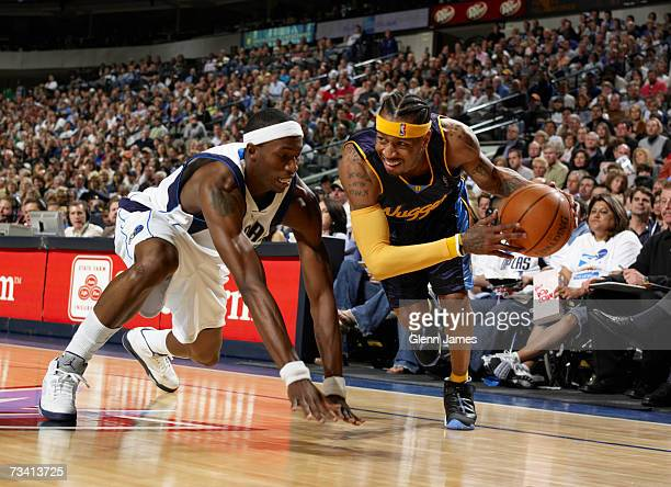 Allen Iverson of the Denver Nuggets drives the baseline against Josh Howard of the Dallas Mavericks at the American Airlines Center February 24 2007...