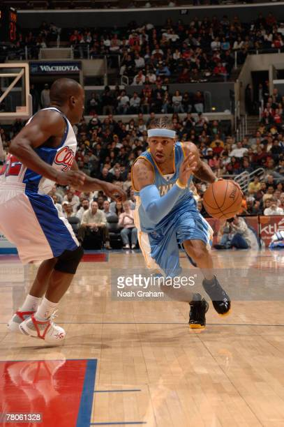 Allen Iverson of the Denver Nuggets drives the lane against Brevin Knight of the Los Angeles Clippers at Staples Center on November 21 2007 in Los...