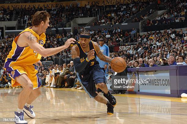 Allen Iverson of the Denver Nuggets drives to the basket against Luke Walton of the Los Angeles Lakers during the game at Staples Center on November...