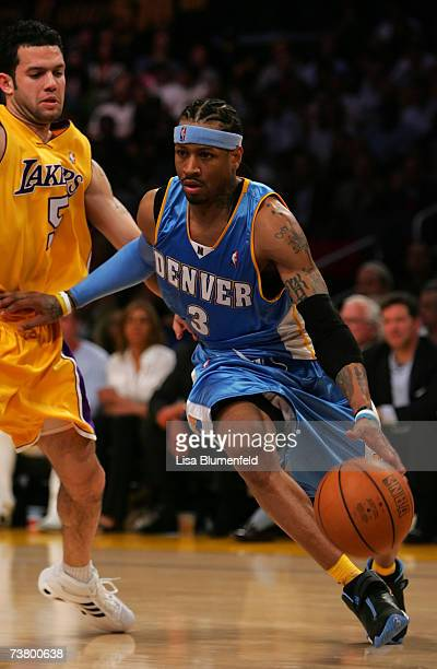 Allen Iverson of the Denver Nuggets drives to the basket against Jordan Farmar of the Los Angeles Lakers at Staples Center April 3 2007 in Los...