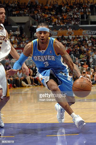 Allen Iverson of the Denver Nuggets drives to the basket against Jordan Farmar of the Los Angeles Lakers in Game One of the Western Conference...