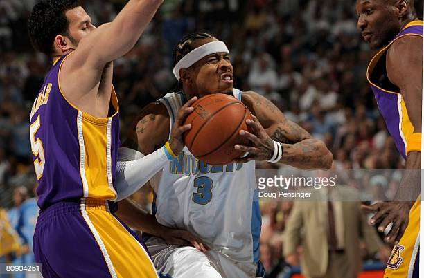 Allen Iverson of the Denver Nuggets drives to the basket against Jordan Farmar of the Los Angeles Lakers in Game Four of the Western Conference...