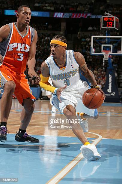 Allen Iverson of the Denver Nuggets drives to the basket against Boris Diaw of the Phoenix Suns during the game against the Phoenix Suns on April 1...