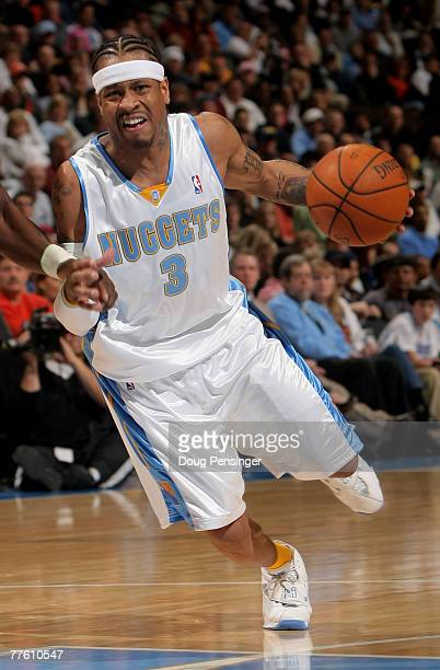 Allen Iverson of the Denver Nuggets drives to the basket against the Seattle SuperSonics at the Pepsi Center on October 31 2007 in Denver Colorado...