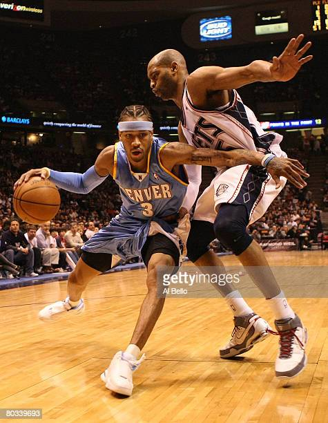Allen Iverson of the Denver Nuggets drives to the basket as Vince Carter of the New Jersey Nets defends during their game on March 21 2008 at the...
