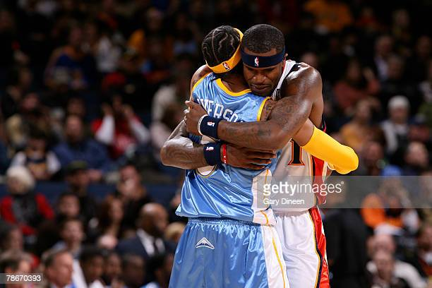 Allen Iverson of the Denver Nuggets embraces Stephen Jackson of the Golden State Warriors pregame on December 28 2007 at ORACLE Arena in Oakland...