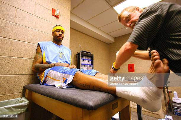 Allen Iverson of the Denver Nuggets gets his ankle wrapped before the game against the Philadelphia 76ers on March 19 2008 at the Wachovia Center in...