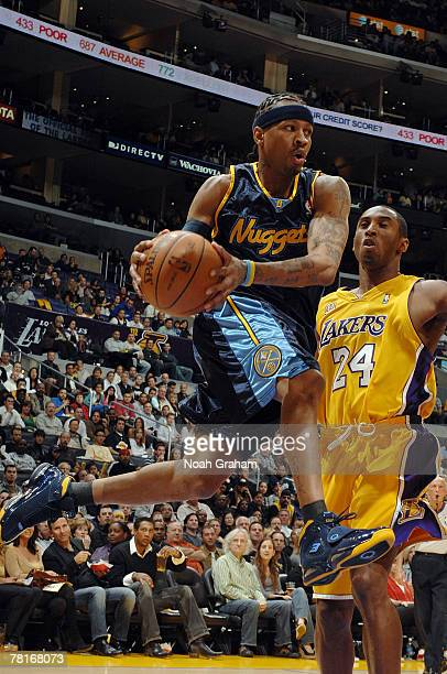 Allen Iverson of the Denver Nuggets goes to the basket against Kobe Bryant of the Los Angeles Lakers at Staples Center November 29 2007 in Los...