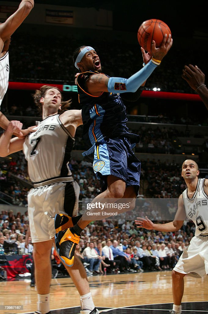 Allen Iverson #3 of the Denver Nuggets goes to the basket against Fabricio Oberto #7 of the San Antonio Spurs in Game Two of the Western Conference Quarterfinals during the 2007 NBA Playoffs at AT&T Center on April 25, 2007 in San Antonio, Texas.