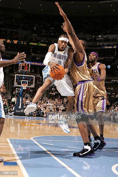 Allen Iverson of the Denver Nuggets goes to the basket against the Sacramento Kings at the Pepsi Center on December 22 2006 in Denver Colorado NOTE...