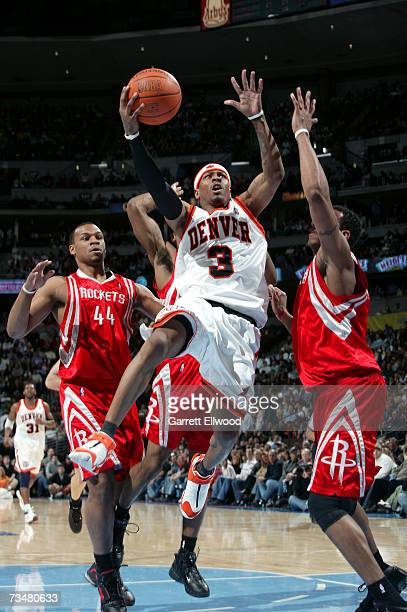 Allen Iverson of the Denver Nuggets goes to the basket against the Houston Rockets on March 2 2007 at the Pepsi Center in Denver Colorado NOTE TO...